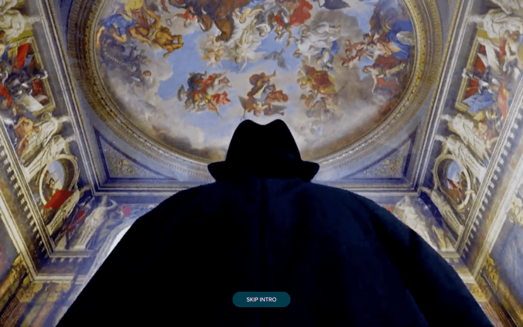 A screenshot from a website showing a still from a video. The back of Churchills head is silhouetted and can be seen looking up at the decorative ceiling of Blenheim Palace.