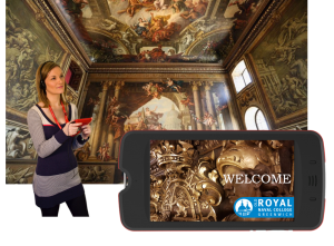 Picture of visitor at Old Royal Naval College using a multimedia guide