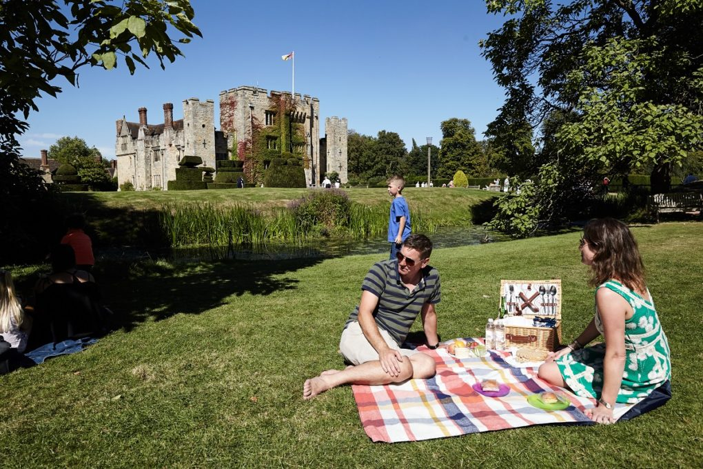 Picnic on grass with Hever Castle in the background